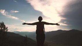 Tourist on the high mountain enjoying the view. girl winner happily raises her hands stock footage