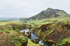 Tourist on a hike in Iceland near the Skoga River stock photos
