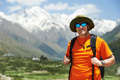 Tourist hiker with backpack in mountains Stock Photos
