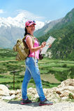 Tourist hiker with map in mountains Royalty Free Stock Photo