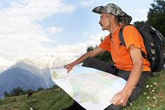 Tourist hiker with map in mountains Royalty Free Stock Photos
