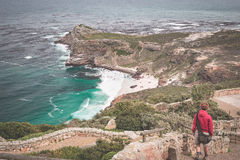 Tourist hiking at Cape Point, looking at view of Cape of Good Hope and Dias Beach, travel destination in South Africa. Table Mount Stock Image