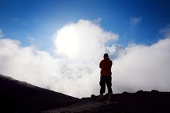 Tourist hiking in Haleakala volcano crater on the Sliding Sands trail. Beautiful view of the crater floor and clouds below. Maui, Royalty Free Stock Photography