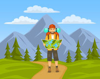 Tourist hiking in mountains. Man holding, looking at map Royalty Free Stock Photo