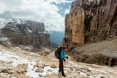Tourist hiking in mountains Sella Ronda Royalty Free Stock Photos