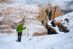 Tourist hiking in mountains Sella Ronda Stock Photo