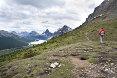 A tourist on a hiking trail in Banff Stock Images