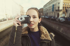 Tourist Hipster Girl Making Photo With Retro Camera Royalty Free Stock Image