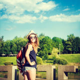 Tourist Hipster Girl Relaxing in the Park Royalty Free Stock Photography