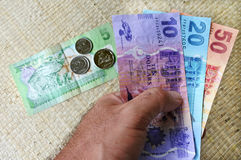 Tourist hold a Fijian money currency Stock Photography