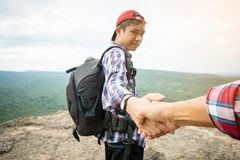Tourist hold helping hand Royalty Free Stock Images