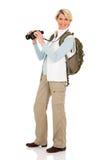 Tourist holding binoculars Stock Photo