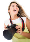 Tourist holding a camera Royalty Free Stock Image