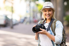 Tourist holding camera Stock Photography
