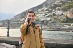 Tourist holding a camera stock photos