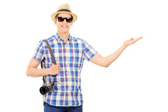 Tourist holding a camera and gesturing with hand Stock Photo
