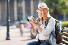 Tourist holding camera Stock Photos