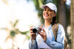 Tourist holding camera Stock Images