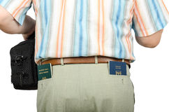 Tourist holding Israeli and Tonga passports in rear pockets Royalty Free Stock Photography