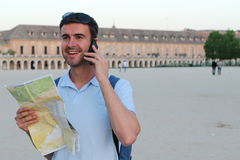 Tourist holding map and calling by phone Stock Photos