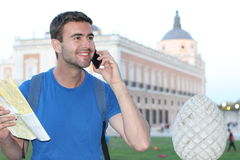 Tourist holding map and calling by phone with copy space Stock Images