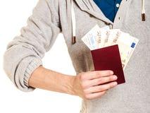 Tourist holding passport full of money. Stock Photography