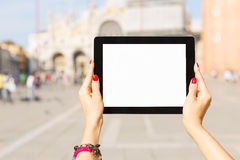 Tourist holding tablet computer with blank white screen Royalty Free Stock Image