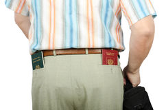 Tourist holding Tonga and Russian passports in rear pockets Stock Images