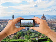 Tourist holds up camera mobile at Florence Royalty Free Stock Photography