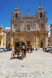 Tourist horse carriage on the St Paul`s Square, Mdina, Malta. Stock Photography