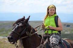 Tourist on horseback Royalty Free Stock Image