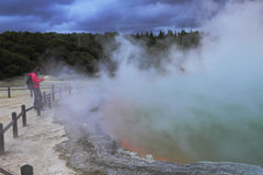 A tourist by the hot spring Royalty Free Stock Photography