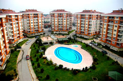 Tourist hotel complex. Aerial view of modern tourist hotel complex with swimming pool in park Royalty Free Stock Photo