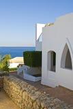 Tourist hotel by ocean Stock Photos
