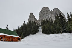 Tourist hut in the mountains in winter time Stock Image