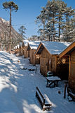 Tourist Hut. A series of snow covered wooden made tourist hut at Yumthang valley in Sikkim, India which remain closed due to heavy snowfall Royalty Free Stock Image