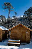 Tourist Hut. A series of snow covered wooden made tourist hut at Yumthang valley in Sikkim, India which remain closed due to heavy snowfall Stock Image
