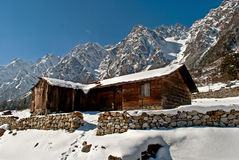Tourist Hut. A series of snow covered wooden made tourist hut at Yumthang valley in Sikkim, India which remain closed due to heavy snowfall Stock Photography