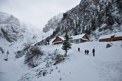 Tourist hut on the winter in mountains Royalty Free Stock Photos
