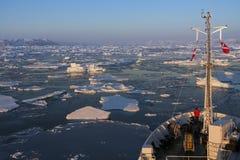 Tourist Icebreaker - Greenland. A tourist icebreaker and sea ice off the coast of eastern Greenland Stock Image
