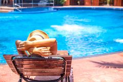 Tourist In Hat Lies On Louger Near Swimming Pool For Relax Summer Vacation Concept. Royalty Free Stock Photography