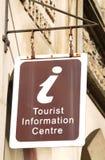 Tourist information centre. Vintage tourist information centre sign suspended on a historic building Stock Images