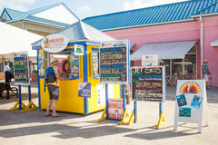 Tourist INformation Centre in Cayman Islands. Man inquiring at the tourist information centre Stock Images