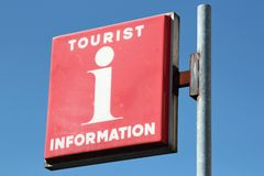 Tourist information. Red tourist information sign against blue sky Royalty Free Stock Images