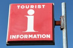 Tourist information. Red tourist information sign against blue sky Stock Image