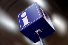 Tourist information sign. With blurred lights in background Stock Photo