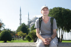 Tourist in Istanbul. Tourist with backpack in Istanbul against Blue Mosque Stock Photo