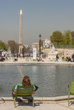 Tourist  in Jardin des Tuileries - Paris, France. Stock Photo