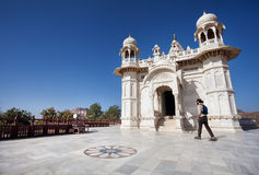 Tourist in Jaswant Tada in Jodhpur. JODHPUR, RAJASTHAN, INDIA - MARCH 09, 2015: Foreign tourist walking near Royal Cenotaph memorial from white marble – royalty free stock images
