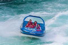 Tourist jet at Huka Falls, Waikato river, New Zealand